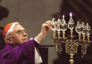Jewish Benedict lights a menorah