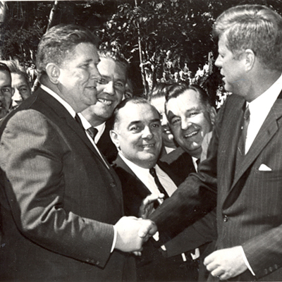 John F. Kennedy photographed in another Masonic handshake with Patrick J Mellody, Lackawanna County Democratic chairman. Looking on from left, Edward Zipay, Santo Pacoe and Edward Popil