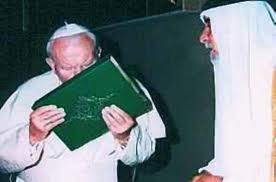 John Paul II kisses a koran