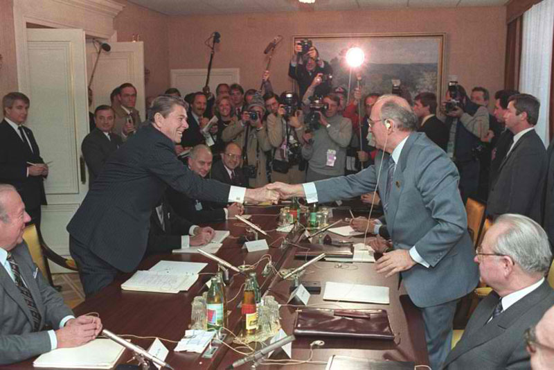 Reagan and Gorbachev exchange a Masonic handshake to end their contrived conflict.
