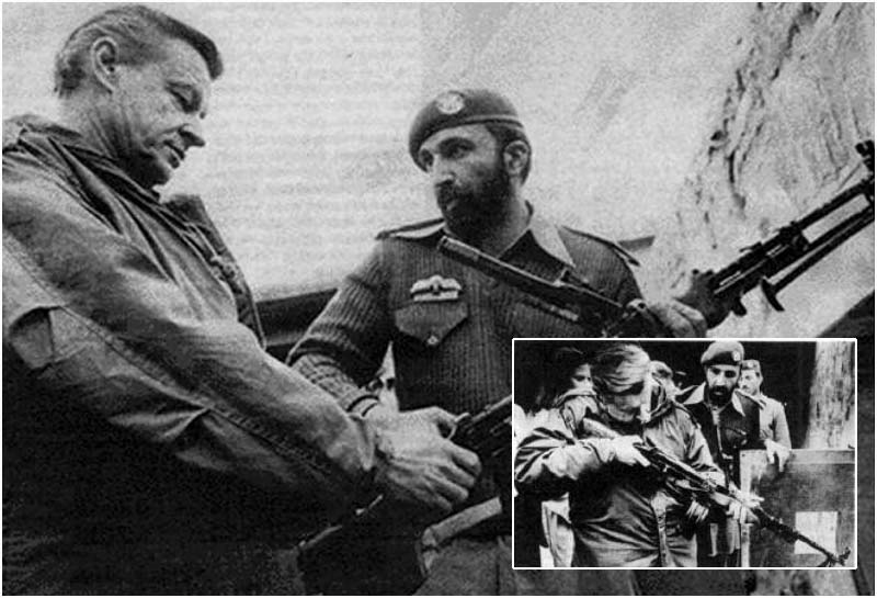 Zbigniew Brezinski inspects a firearm with Osama bin Laden around 1979 when he was U.S. Secretary of State