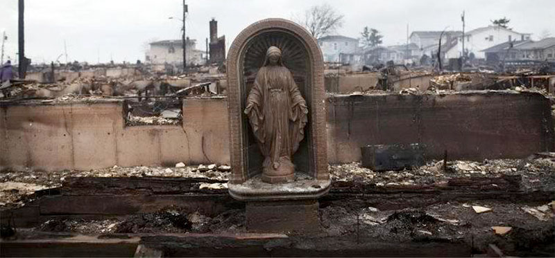 A statue of God survives the possible man-made hurricane on the Eastern Coast near New York City in October, 2012