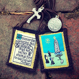 The Scapular acts as a Mark of Our Lady, specifically for those who are marked with the names of the Masonic Trinity, the Father, son, and the holy spirit. The mark of Our Lady overrides these errors for those who are naive to the end-times apostasy.
