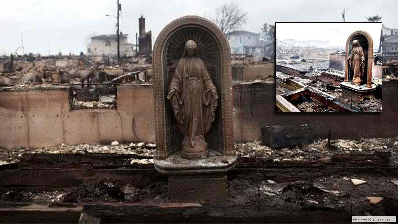 A statue of God survives a manifactured hurricane in Breezy Point, N.J.